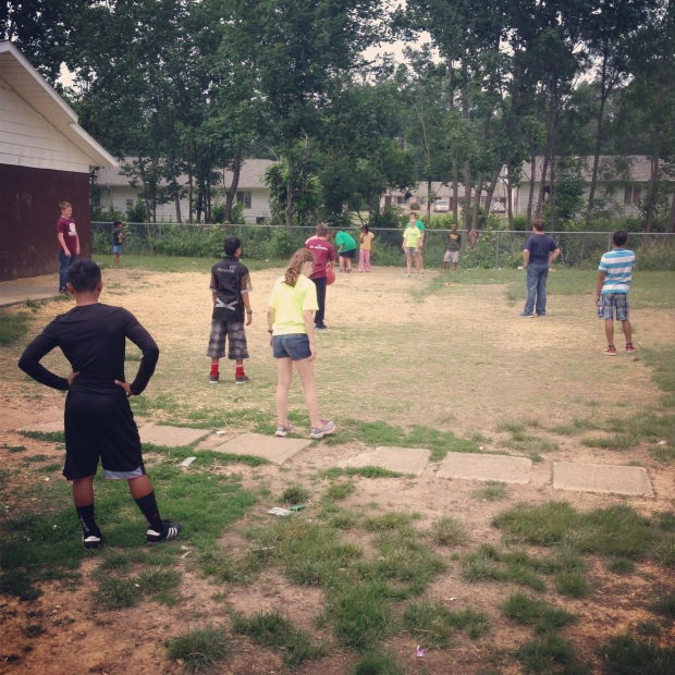 Impact 52 plays kickball with Burmese children