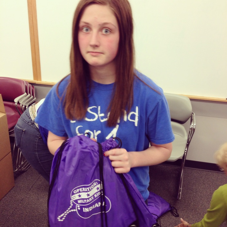 Impact 52 fills backpacks for military youth
