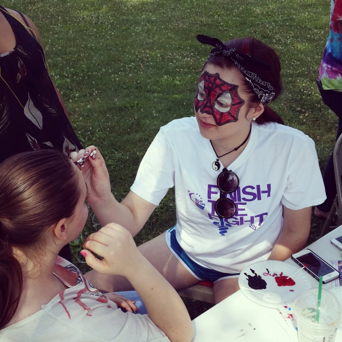 Impact 52 paints faces at the Back To School Bash