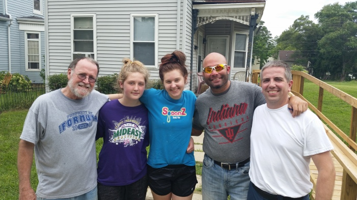 Impact 52 and friends paint for a neighbor in need